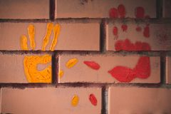 Hand-prints on the wall. Rough stock image