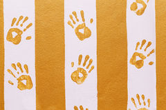 Hand prints on the wall. Hand prints on yellow and pink wall royalty free stock image