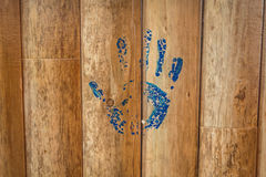 Hand prints on wooden wall. Hand prints on wooden wall stock photo