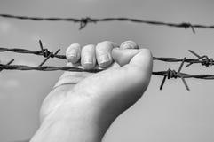 Hand of prisoner Stock Photo