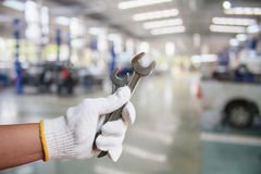 Hand of professional Auto mechanic with wrench Stock Photos