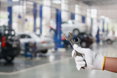 Hand of professional Auto mechanic with wrench Royalty Free Stock Images