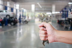 Hand of professional Auto mechanic with wrench Stock Photo