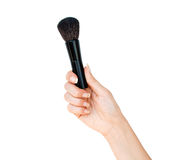 Hand with professional brush for makeup Royalty Free Stock Photography