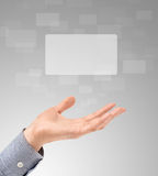 Hand Propose Touch Screens. Business hand propose floating touch screens on a light gray background. Maximum size, ultra quality Royalty Free Stock Photos