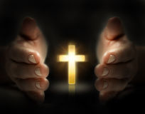 Hand protect cross. The cross shine in the hand Stock Images