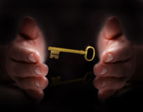 Hand protect golden key. Mean protect security Stock Photos
