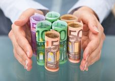 Hand protecting euro banknote Royalty Free Stock Photography