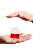 Hand protecting small house Stock Image