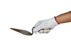 A hand with protection glove holding Building trowel Stock Images