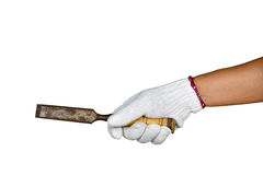 A hand with protection glove holding chisel. With wooden handle on white background stock image