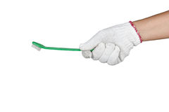 A hand with protection glove holding cleaning brush Stock Images