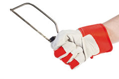 Hand with protection glove holding Hacksaw Royalty Free Stock Photos