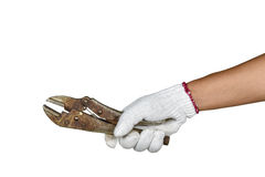 A hand with protection glove holding locking pliers Royalty Free Stock Images