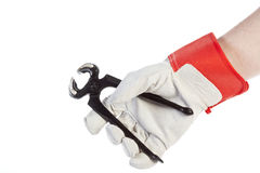 Hand with protection glove holding pincer. Isolated on white background Stock Image