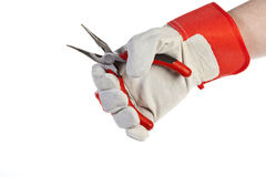 Hand with protection glove holding Pliers Stock Images