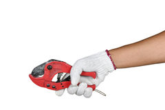 A hand with protection glove holding red scissors for cutting pl Stock Photography