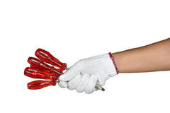 A hand with protection glove holding red screw divers Royalty Free Stock Photo