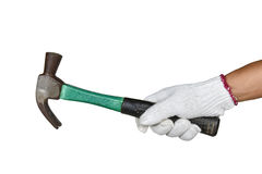A hand with protection glove holding rusty hammer Stock Photo