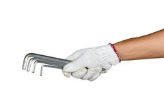 A hand with protection glove holding a various allen keys spanne Royalty Free Stock Image
