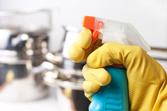 Hand in protective glove holding spray Royalty Free Stock Photos