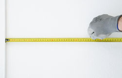 Hand in protective gloves with Metre measure ruler Stock Image
