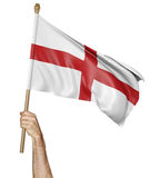 Hand proudly waving the national flag of England Stock Image