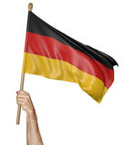 Hand proudly waving the national flag of Germany Royalty Free Stock Image