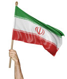 Hand proudly waving the national flag of Iran Stock Photography