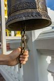 Handle ringing a bell in a Buddhist temple stock photography