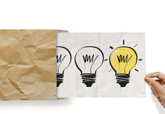 Hand pull crumpled paper show light bulb out of recycle envelope Stock Photo