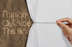 Hand pull wrinkled paper show think outside the box Stock Photos