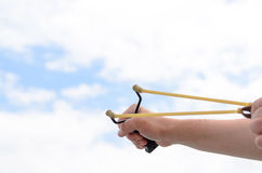 Hand Pulling Bands of his Stone Shooter Stick Royalty Free Stock Photo