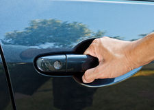 A hand pulling car door handle Stock Photography