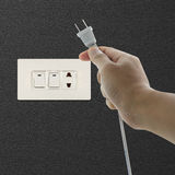Hand pulling electrical plug. Concept of energy conservation Stock Images