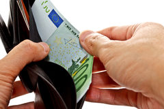 Hand pulling Euro banknote from wallet Stock Image