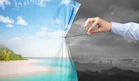 Hand pulling green landscape curtain to gray landscape. Environmental protection concept stock image