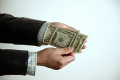 Hand pulling money from sleeve Stock Photography