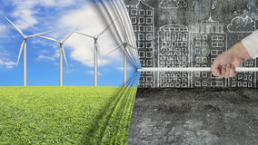 Hand pulling open wind turbines curtain covering gray cityscape Royalty Free Stock Photography