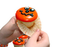 Hand Pulling Paper of Halloween Cupcake Royalty Free Stock Photography