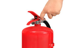Hand pulling pin fire extinguisher Stock Image