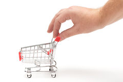 Hand pulling shopping cart Royalty Free Stock Photo