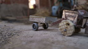 Hand pulling truck toy on ground in house in Jodhpur, closeup. stock video