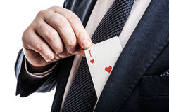 Hand pulls the card ace of hearts Royalty Free Stock Photo