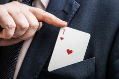 Hand pulls the card ace of hearts Stock Images