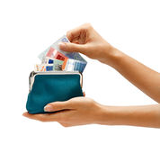 Hand pulls out of purse euro banknotes. Stock Photo