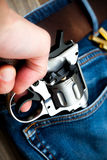 Hand pulls out a revolver from the pocket Stock Image