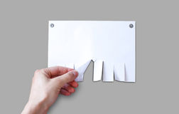 Hand pulls a piece of paper. Empty paper ad loose leaves isolate Stock Photo