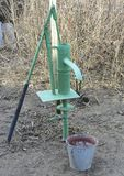 Hand pump leading to an artesian well. Royalty Free Stock Photography