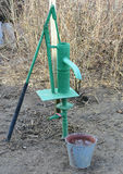 Hand pump leading to an artesian well. Stock Images